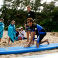 Learn to surf near the Laie Courtyard Marriott and PCC